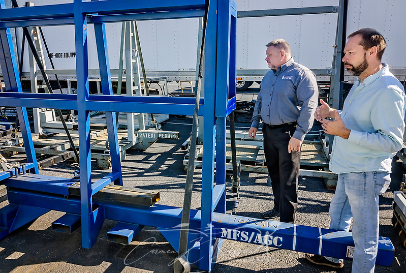 Jim Toussaint, division operations manager of Worldwide Equipment, listens as Grant Mize, vice president of operations at Moore Freight Service, explains the company's proprietary rack system, Oct. 31, 2017, in Mascot, Tenn. The new rack enables customers to preload shipments and allows drivers to offload in less than 15 minutes instead of the two to three hours required with the old system. (Photo by Carmen K. Sisson/Cloudybright) (Carmen K. Sisson/Cloudybright)