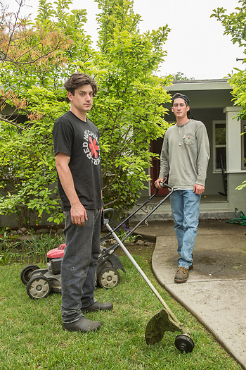 """I work for my dad but eventually I want to go off the grid.""  Donnie McMahn and his younger brother, Jackson, finish up a lawn at the corner of Berry and Myrtle Street in Calistoga. (Clark James Mishler)"