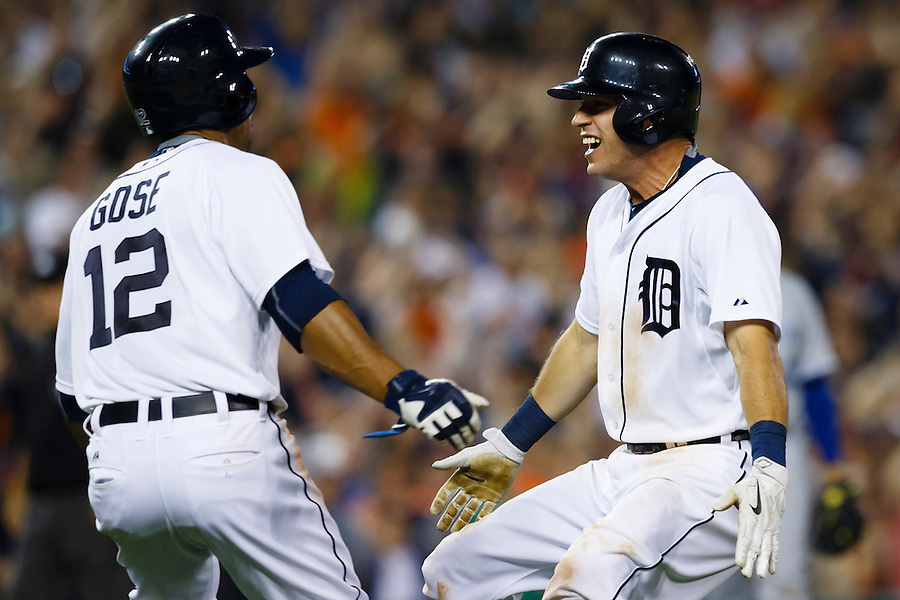 May 8, 2015; Detroit, MI, USA; Detroit Tigers center fielder Anthony Gose (12) and second baseman Ian Kinsler (3) celebrate Kindler bunts for a single scoring Gose in the ninth inning against the Kansas City Royals at Comerica Park. Mandatory Credit: Rick Osentoski-USA TODAY Sports (Rick Osentoski/Rick Osentoski-USA TODAY Sports)