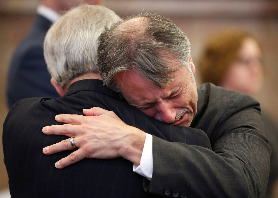 Dr. Daniel Baldi embraces his attorney, Guy Cook after a Polk County jury found him not guilty on all seven involuntary manslaughter charges he had faced. (Christopher Gannon/The Register)