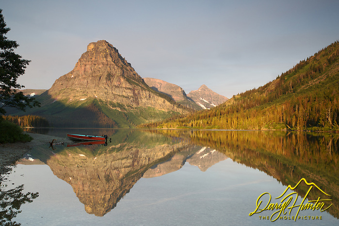 """Mt. Sinopah, sunrise, red boat, Two Medicine Lake, reflection, Glacier National Park (© Daryl Hunter's """"The Hole Picture""""/Daryl L. Hunter)"""