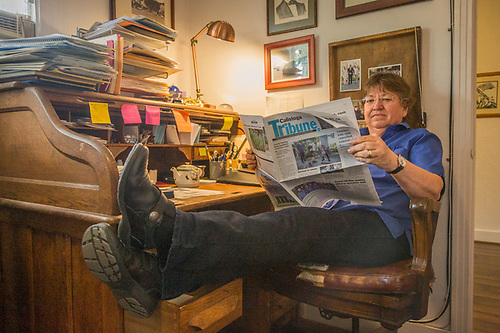 Editor Pat Hampton reads today's paper at her desk at the Calistoga Tribune offices. (Clark James Mishler)