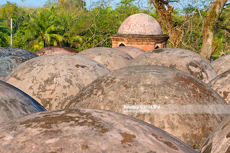 Bagerhat, Bangladesh - February 17, 2014: Shat Gombuj Mosque roof domes in Bagerhat, Bangladesh. UNESCO World Heritage site and the largest mosque in Bangladesh (Sixty Tomb Mosque). (Dmitry Chulov)