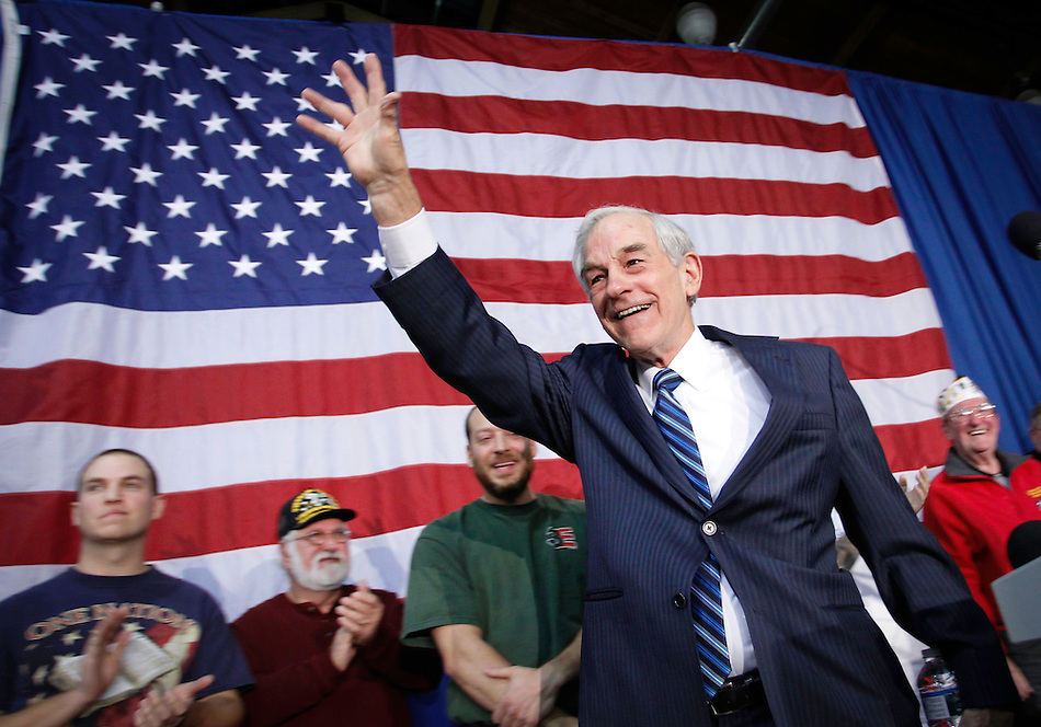 Ron Paul waves to supporters at the conclusion of a campaign speech during an evening rally in Des Moines on December 28. (Christopher Gannon)