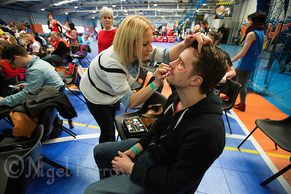 16 MAR 2014 - BIRMINGHAM, GBR - A Team England supporter has his face painted before the start of the bout against Team France during the inaugural Men's Roller Derby World Cup in the Futsal Arena in Birmingham, West Midlands, Great Britain (PHOTO COPYRIGHT © 2014 NIGEL FARROW, ALL RIGHTS RESERVED) (NIGEL FARROW/COPYRIGHT © 2014 NIGEL FARROW : www.nigelfarrow.com)