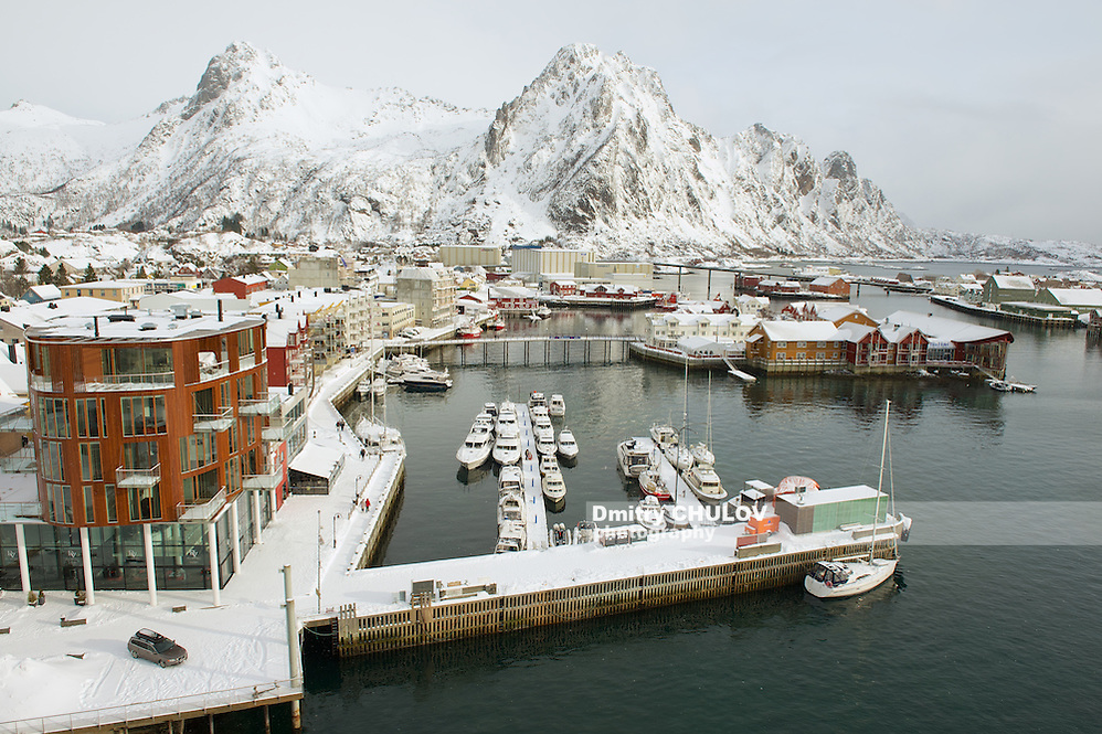 SVOLVAER, NORWAY - MARCH 26, 2011: Svolvaer harbor in Svolvaer, Norway. Svolvaer harbor is the starting point for held yearly in March International cod fishing competition. (Dmitry Chulov)