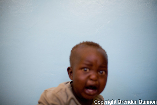 A young Kenyan boy at endebess IDP camp in Kenya following post election violence in 2008.. (Brendan Bannon)