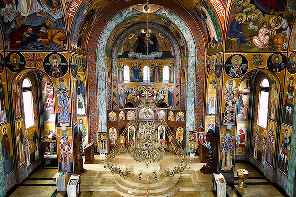 The beautiful Byzantine interior of the All Serbian Saints Orthodox Church, Toronto (Canada). This beautiful church building is built in Byzantine style, which is traditional for Orthodox churches. The building has three balconies for choirs, hand crafted iconostasis, with icons produced in Belgrade. (© Dean Oros Photography + Design)