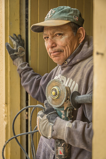 Santa Rosa resident and construction worker Daniel Salgado works on a remodel project on Myrtle Street in Calistoga. (Clark James Mishler)