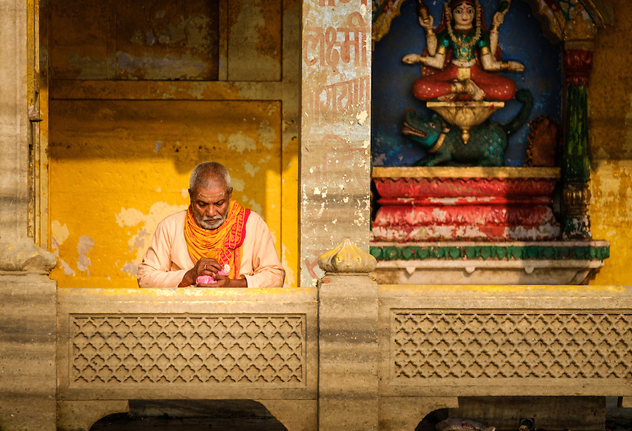 VARANASI, INDIA - CIRCA NOVEMBER 2016: Portrait of a man worshiping in Varanasi. Varanasi is the spiritual capital of India, the holiest of the seven sacred cities. (Daniel Korzeniewski)