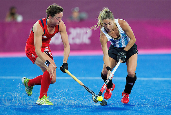 08 AUG 2012 - LONDON, GBR - Hannah Macleod (GBR) of Great Britain (left) challenges Macarena Rodriguez-Perez (ARG) of Argentina for the ball during the London 2012 Olympic Games women's semi final match against Argentina at the Riverbank Arena in the Olympic Park, Stratford, London, Great Britain .(PHOTO (C) 2012 NIGEL FARROW) (NIGEL FARROW/(C) 2012 NIGEL FARROW)