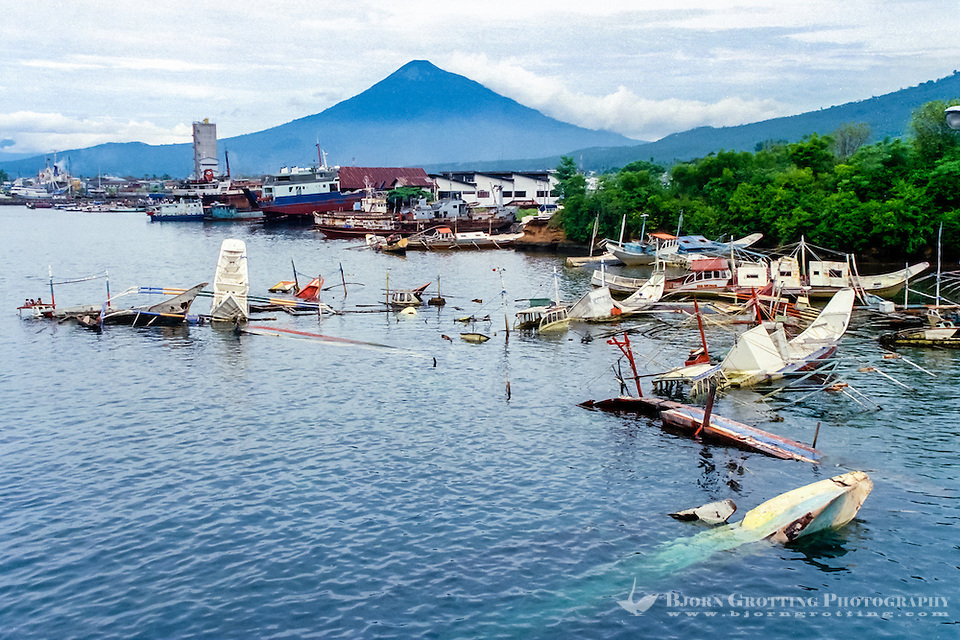 North Sulawesi, Bitung. In the background Gunung Klabat, 2022 m. Sunken illegal fishing vessels, in this case probably confiscated from Philippine fishermen. (Photo Bjorn Grotting)