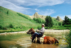 "Chancy Wheeldon, horseback, fishing, Jackson Hole Wyoming. (Daryl Hunter's ""The Hole Picture"" ? Daryl L. Hunter has been photographing the Yellowstone Region since 1987, when he packed up his view camera, Pentex 6X7, and his 35mm's and headed to Jackson Hole Wyoming. Besides selling photography Daryl also publishe/Daryl L. Hunter)"