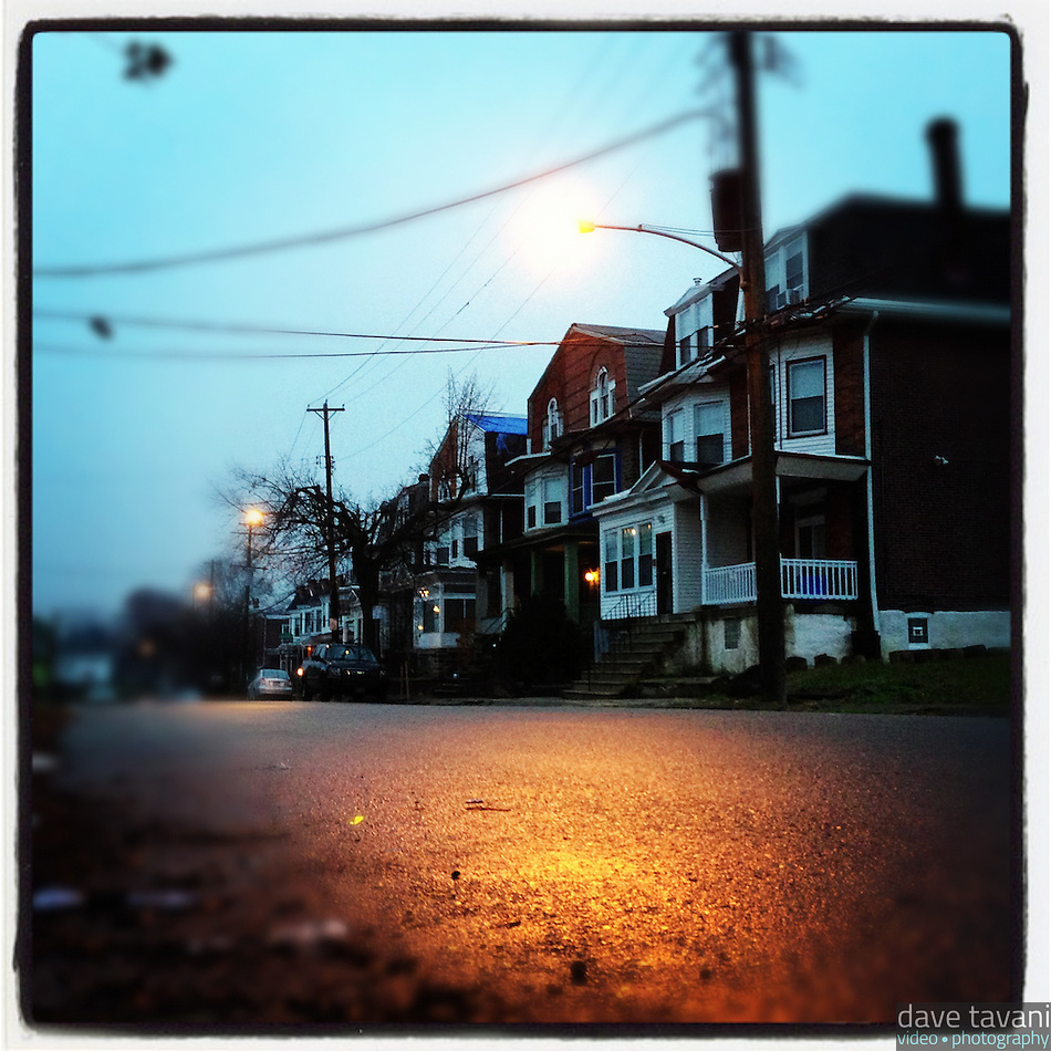 This shot is only a few steps from the one the day before. The light is very different: soft, diffuse, almost not there except for that street light that reflects in the wet pavement. This shot was taken on the 6300 block of Cherokee Street in the Germantown section of Philadelphia on December 7, 2012. (Dave Tavani)