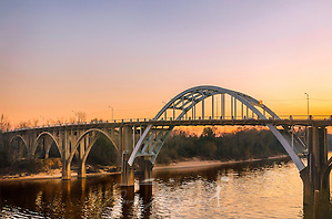 """The sun sets behind the Edmund Pettus Bridge, Feb. 14, 2015, in Selma, Alabama. The bridge was the site of """"Bloody Sunday,"""" where state troopers and local law enforcement attacked civil rights activists as they attempted to march from Selma to Montgomery, March 7, 1965. (Photo by Carmen K. Sisson/Cloudybright) (Carmen K. Sisson/Cloudybright)"""