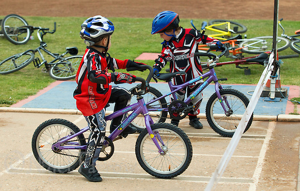 12 JUN 2015 - IPSWICH, GBR - Riders prepare to practice starts during an Ipswich Cycle Speedway Club Academy training session at Whitton Sports and Community Centre in Ipswich, Suffolk, Great Britain (PHOTO COPYRIGHT © 2015 NIGEL FARROW, ALL RIGHTS RESERVED) (NIGEL FARROW/COPYRIGHT © 2015 NIGEL FARROW : www.nigelfarrow.com)