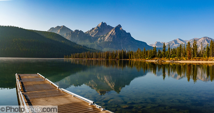 Sawtooth Wilderness reflects in Stanley Lake at the boat dock. Sawtooth National Recreation Area, Idaho, USA.  (© Tom Dempsey / PhotoSeek.com)