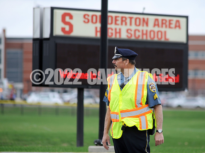SOUDERTON, PA - APRIL 14:  A police officer stands guard outside the entrance after a bomb threat forced the evacuation of Souderton High School April 14, 2014 in Souderton, Pennsylvania. (Photo by William Thomas Cain/Cain Images) (William Thomas Cain)