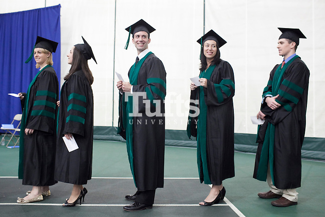 05/22/2011 - Medford, Mass. - From left, Katherine Dunn, Margarita Ebril, David Johnson Einstein, Norah Emara and Daniel Fay, all M11, wait to receive their degrees during commencement for the Tufts University School of Medicine on May 22, 2011. (Kelvin Ma/Tufts University) (Kelvin Ma/Tufts University)