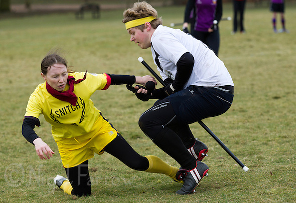 08 MAR 2015 - NOTTINGHAM, GBR - Leicester Thestrals' seeker Joseph Wilson succeeds in taking the snitch from the back of snitch runner Nicole Stone's shorts during the match against Durhamstrang at the 2015 British Quidditch Cup in Woollaton Hall and Deer Park in Nottingham, Great Britain (PHOTO COPYRIGHT © 2015 NIGEL FARROW, ALL RIGHTS RESERVED) (NIGEL FARROW/COPYRIGHT © 2015 NIGEL FARROW : www.nigelfarrow.com)