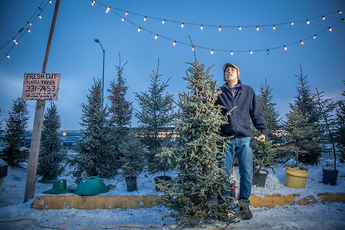 "Christmas tree salesman Bobby Sperb on Northern Lights Blvd. in Anchorage.  ""I was a merchant marine until 1991 and then I taught elementary school on the Kenai Peninnsula.  I was diagnosed with Parkensen desease in 1996 and now I work about two hours a week.  Having my photograph made…I feel like a celebrity.""  764-7168 or 331-7453 (© Clark James Mishler)"