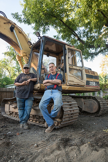 """Dave used to work for me, now I work for him.  He yells at me a lot but I guess that's fair because thats what I did to him.""  -78 year old Don Wesner, from Rutherford, and his son, Dave, from Angwin, take a break after a long week of clearing a lot in Calistoga. (Clark James Mishler)"