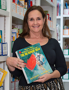 Cindy Puryear poses for a photograph in the leveled reading library at Roberts Elementary School, June 10, 2014. (Houston ISD/Dave Einsel)