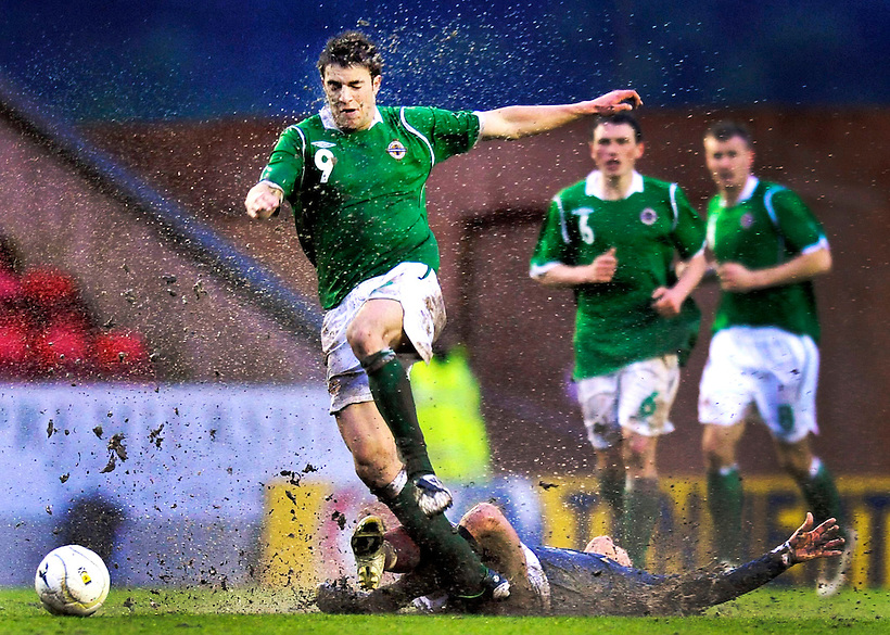 6TH MAY 2009, SCOTLAND B  V NORTHERN IRELAND B AT BROADWOOD STADIUM, CUMBERNAULD, ANDREW LITTLE BURSTS THROUGH THE MUD, ROB CASEY PHOTOGRAPHY. (ROB CASEY/ROB CASEY PHOTOGRAPHY)