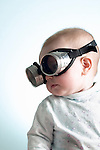Portrait of 6 month old baby girl wearing welders goggles over eyes (Brad Mitchell/Brad Mitchell Photography)