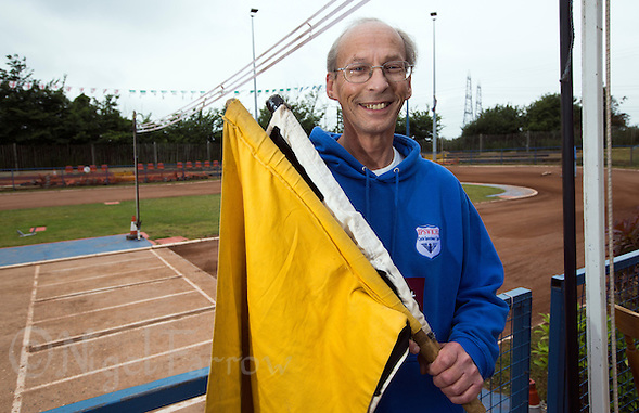 "14 JUN 2015 - IPSWICH, GBR - Ipswich Eagles flag man Steve Rumbold at the team's track at Whitton Sports and Community Centre in Ipswich, Suffolk, Great Britain. Father of elite team rider Charlie Rumbold, he was once removed from his flag man duties during a match when he ""questioned"" an opposition riders actions as the excitement of the moment took over (PHOTO COPYRIGHT © 2015 NIGEL FARROW, ALL RIGHTS RESERVED) (NIGEL FARROW/COPYRIGHT © 2015 NIGEL FARROW : www.nigelfarrow.com)"