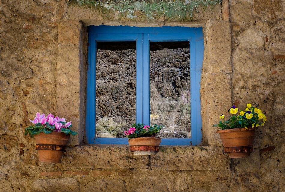 CIVITA DI BAGNOREGIO ITALY - CIRCA MAY 2015: Decorated window with flower pots in Civita di Bagnoregio. (Daniel Korzeniewski)