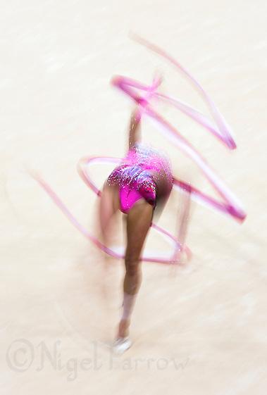11 AUG 2012 - LONDON, GBR - Aliya Garayeva (AZE) of Azerbaijan performs her ribbon routine during the 2012 London Olympic Games Individual All-Around Rhythmic Gymnastics final at Wembley Arena in London, Great Britain (PHOTO (C) 2012 NIGEL FARROW) (NIGEL FARROW/(C) 2012 NIGEL FARROW)