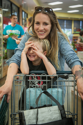 "Culinary Liaison-Forager Candice Koseba with her son, Harrison (5), at Trader Joes in Santa Rosa.  ""I'm in the middle of starting a restaurant and I am crazy busy."" (Clark James Mishler)"