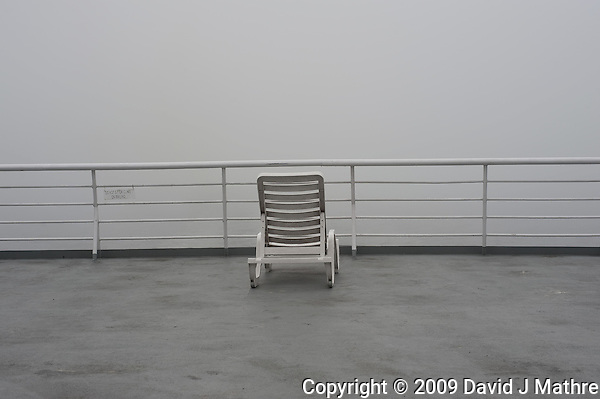 Lone Deck Chair on Misty Morning. Solarium Deck on the MV Columbia Alaska Marine Highway Between Bellingham, Washington and Haines, Alaska. Image taken with a Nikon D3 camera and 50mm f/1.4 lens (ISO 200, 50 mm, f/8, 1/1000 sec). (David J Mathre)