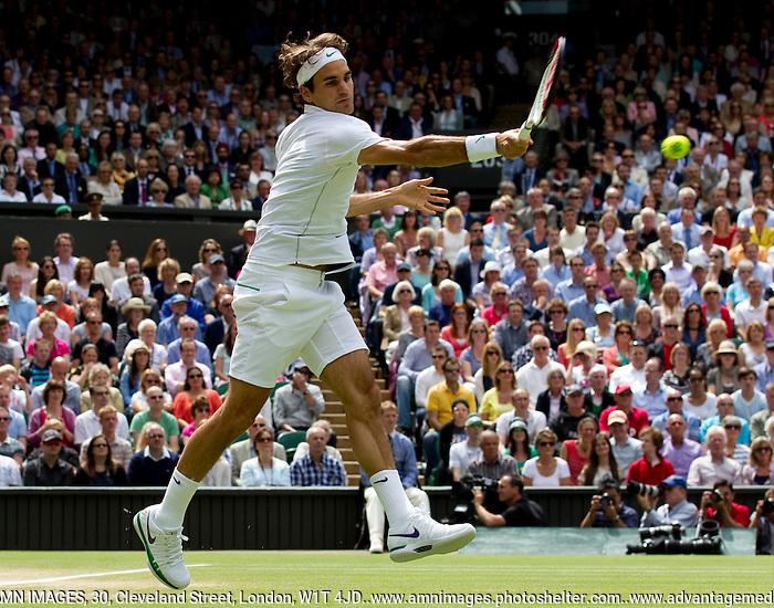 Roger Federer ..Tennis - Grand Slam - The Championships Wimbledon - AELTC - The All England Club - London - Sun July 8h 2012. .© AMN Images, 30, Cleveland Street, London, W1T 4JD.Tel - +44 20 7907 6387.mfrey@advantagemedianet.com.www.amnimages.photoshelter.com.www.advantagemedianet.com.www.tennishead.net (FREY - AMN IMAGES)
