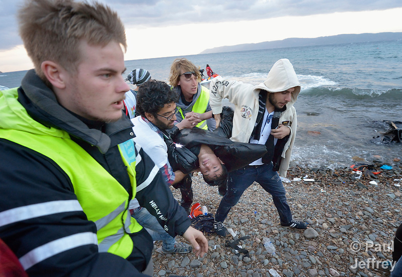 An Afghan refugee was pulled from the water by Spanish lifeguards and rushed to a medical tent on a beach near Molyvos, on the Greek island of Lesbos, on October 30, 2015. He was on a boat full of refugees that capsized on its way from Turkey. The boat was provided by Turkish traffickers to whom the refugees paid huge sums to arrive in Greece. Although his body temperature had dropped to almost 80 degrees, the volunteer medical team on the beach kept him alive, and he was later transported to a hospital in Mytilene. He was expected to survive. (Paul Jeffrey)