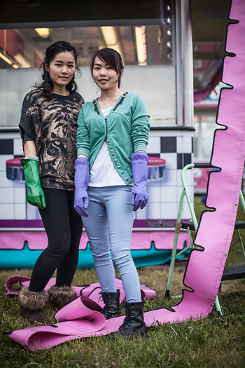 Chinese summer workers, Danny Chen and Joky Wu assist with the set up of a food booth in preparation for the Fourth of July celebration on the Delaney Park Strip, Anchorage (Clark James Mishler)