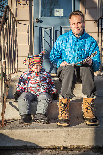 "Jason Geck and his two year old son, Tucker, on the porch of their home in Anchorage's South Addition neigborhood  ""No, we wouldn't normally be sitting on our front porch in February, but this weather is amazing, and here we are."" (© Clark James Mishler)"