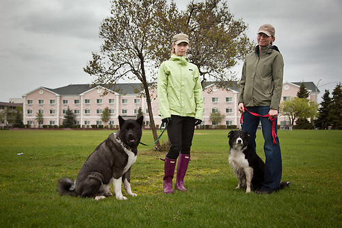 Greer Gehler (left), with 2 year old Kuma and Jenny Davis with 5 year old Kodi on the Delaney Park Strip, downtown Anchorage (Clark James Mishler)
