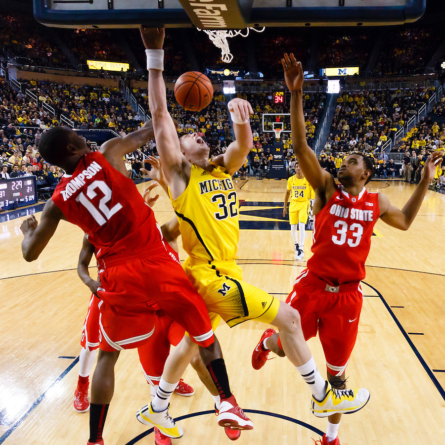 Feb 22, 2015; Ann Arbor, MI, USA; Michigan Wolverines forward Ricky Doyle (32) is fouled by Ohio State Buckeyes forward Sam Thompson (12) in the first half at Crisler Center. Mandatory Credit: Rick Osentoski-USA TODAY Sports (Rick Osentoski/Rick Osentoski-USA TODAY Sports)