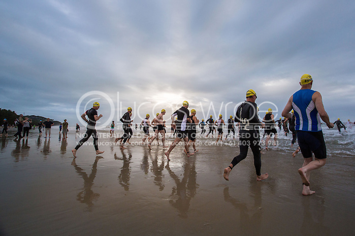 Age Group Competitors enter the water at the swim start, June 1, 2014 - TRIATHLON : Coral Coast 5150 Triathlon, Cairns Airport Adventure Festival, Four Mile Beach, Port Douglas, Queensland, Australia. Credit: Lucas Wroe (Lucas Wroe)