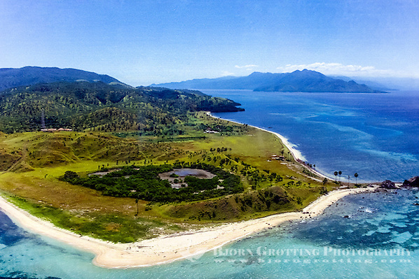 Maluku, South East Maluku, Pulau Liran. The south west tip of Liran. Looking north east with Wetar in the background. There is only a small village and a lighthouse here (from helicopter). (Photo Bjorn Grotting)