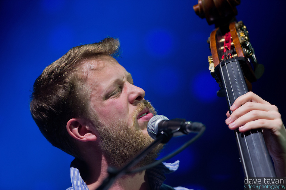 "Ted Dwayne sings and plays the upright bass during the hit ""Little Lion Man,"" from Mumford & Sons' debut album Sigh No More at the Susquehanna Bank Center on February 16, 2013. (Dave Tavani)"