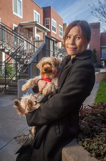Amy Lai with her dog, Harley, at North Beach Place, San Franisco, CA.  Bridge Housing, San Francisco, Bay area (Clark James Mishler)