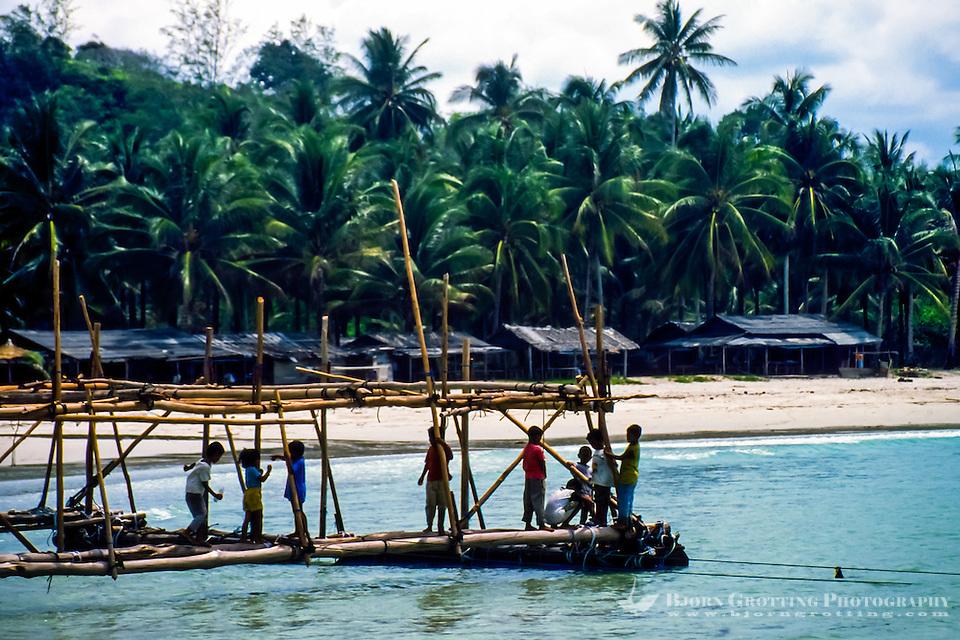 Riau Islands, Bintan. Kids playing outside a small village on Trikora Beach. (Bjorn Grotting)