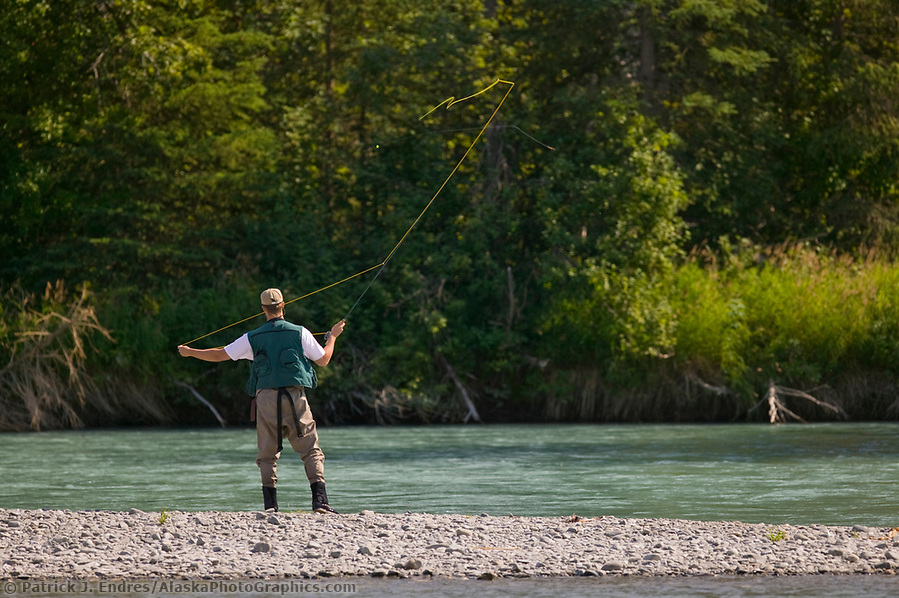 Alaska tourism photos: Fly fishing for red salmon on the Kenai River, Kenai Peninsula, Alaska (Patrick J. Endres / AlaskaPhotoGraphics.com)