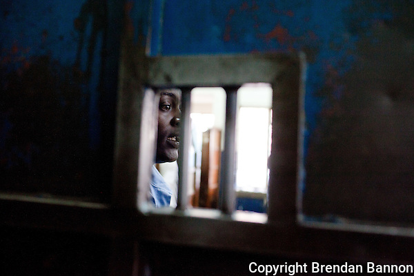 A guard stands outside of the holding cells in Nairobi's Central Police Station. (Photographer: Brendan Bannon)