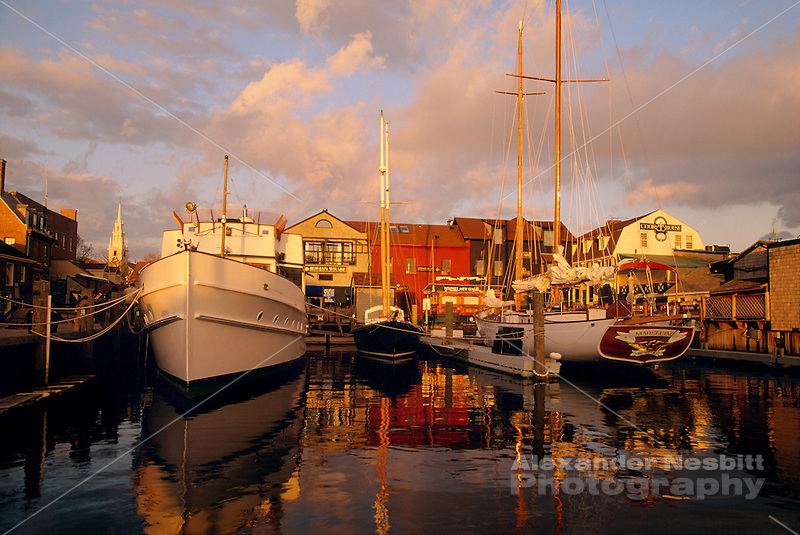 USA, Newport, RI - Boats resting at the Bowen's wharf dock in the late afternoon light... (Alexander Nesbitt)
