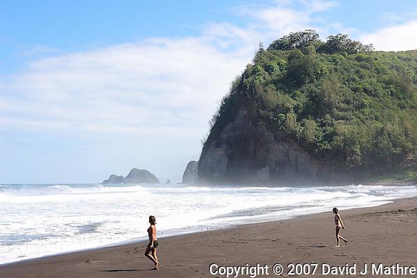Running to the Ocean Waipi�o Valley Beach. Big Island Hawaii. Image taken with a Nikon D2xs and 17-35 mm f/2.8 lens (ISO 100, 35 mm, f/8, 1/125 sec). (David J. Mathre)