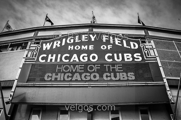 Wrigley Field sign in black and white. Wrigley Field is home of the Chicago Cubs and was built in 1914 making it one of the oldest baseball stadiums in the United States. (Paul Velgos)